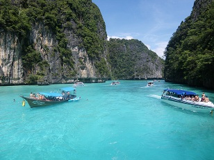 Koh Phi Phi, Thailand - This photo shows the gorgeous bays around Koh Phi Phi, Thailand. It is a truly stunning island with fantastic limestone cliffs and crystal clear blue water!