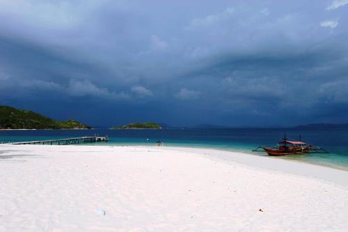 beach - a blue beach with white sands
