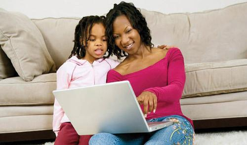 Family Time Online - A woman spending time with her child online.
