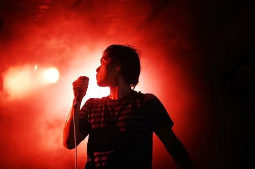 singer - a singer in red light background