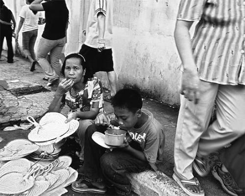 poverty - people with poverty issues in the Philippines. shows inefficiency of government to support its people.