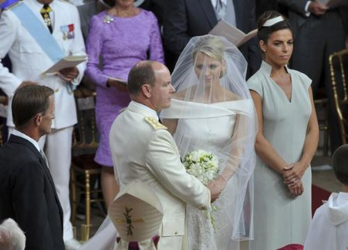 The ceremony - On saturday Prince Albert finally got married to Princess Charlene. On albert's right is his best man and on Charlene's left is her maid od honor.