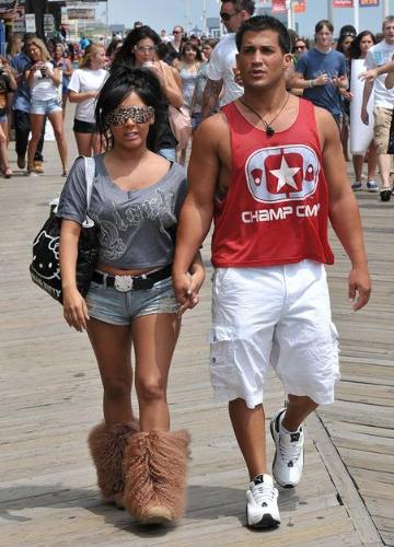 Snookie - She looks weird in those spotted sunglasses and big foot boots! Boyfriend looks hot,though!
