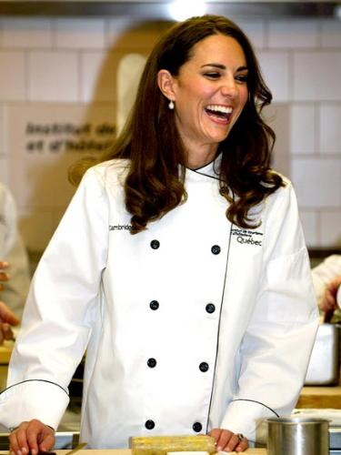In a chef's jacket - Kate and Williams toured a kitchen and Kate was given a chef's jacket to wear!