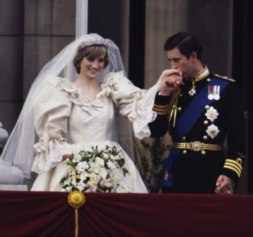 Their wedding day. - Diana was so in love with Charles on that day and he acted like he was where her!