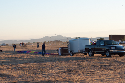 Laid out - The launch team has laid out the balloon's envelope and is getting ready to begin inflating it. I believe the balloon is Dancing in Air.
