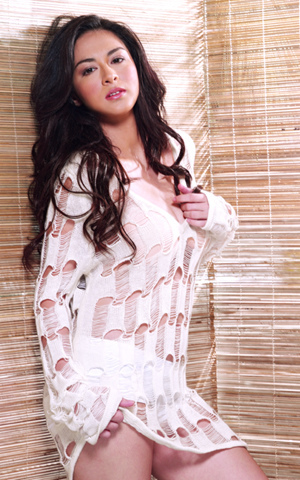 See through shirt - The female artist name is Marian Rivera an actress here in Philippines