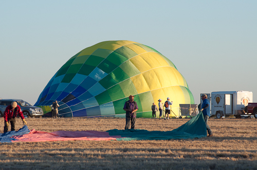 Calypso takes form - The hot air balloon Calypso is inflated by its launch team. Arizona Dawn's envelope is in the foreground.