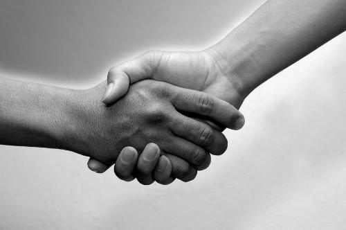 hands - photo of two people shaking hands