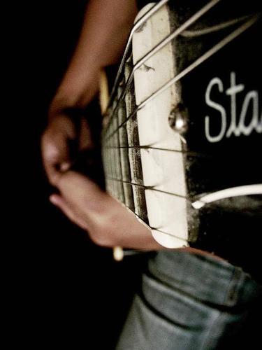 guitar -  a guitar player.