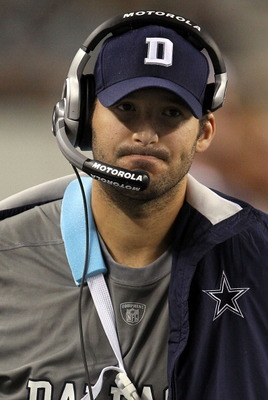 Tony Romo - Tony Romo walking the sidelines at a game. He had the broken collarbone then and Jon Kitna was his replacment.