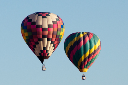 Arizona Dawn and Her Highness - Two hot air balloons in flight.