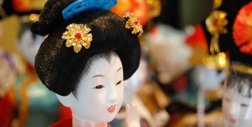 doll  - a geisha doll on parade.