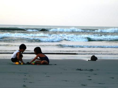 kids - picture of kids playing at the shore befor tsunami warning in Philippines.