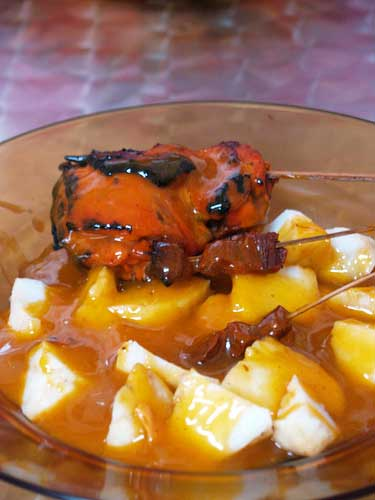 satti - Yummy! The white thing is rice..and that is barbeque at its side..usually it is small pieces of beef in the bbq stick but they also serve chicken bbq..the sauce is thick and spicy and smells great..i do not know what is in it.. but i know it is different spices combined.
