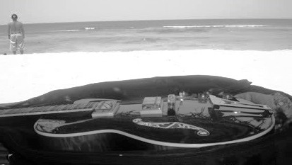 guitar - guitar left in the shore to gather dust and moisture.