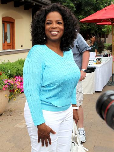 Oprah - Oprah Winfrey. She is looking good! I love her sweater!