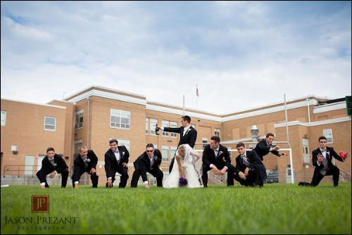 Wedding photo - This is a wedding photo from Baltimore Raven's Joe Flacco's wedding. He is the Raven's QB so he his whole wedding party became his offense like! His bride in the center! How funny is that? Very funny!