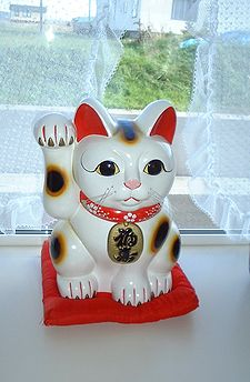 Beckoning cat - This is Beckoning cat from Japan. It is suppose to be luck,wealth and happiness to homes who have one.