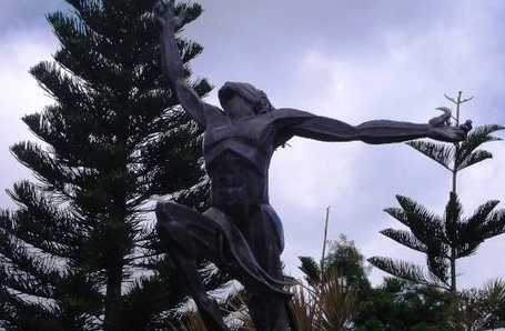 art - sculpture of a person having back pains.