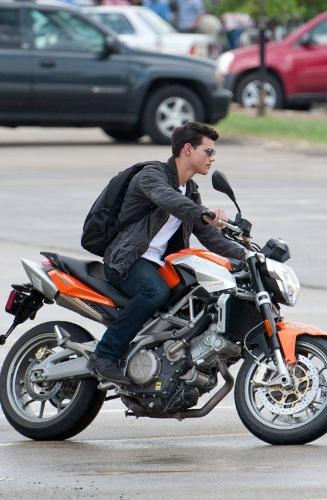taylor lautner on a motorcycle - Admit it, he's hot.