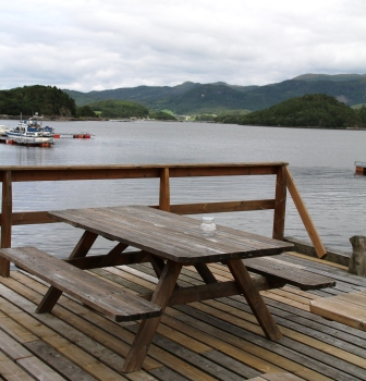 Bench by a fjord - Bench at a pub by a fjord