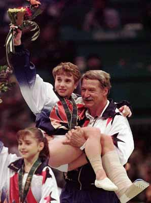 helping hand - In 1996 Summer games in Atlanta,USA gymnist Kerry Scruggs won the gold in the woman's vault on a bad leg! Coach Bela Karoli is giving her a left here!