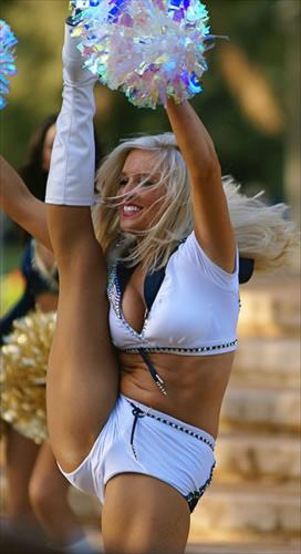 Cheerleader - An NFL Cheerleader. Boy, can she kick high! Unreal!