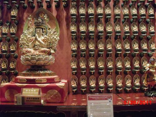Small Buddha statues - Small Buddha statues adorn the inner wall of the Chinese temple