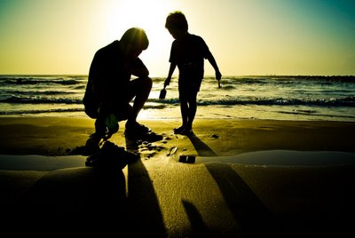 Father and Son - A wonderful picture of Father and Son with the sunset on the background.