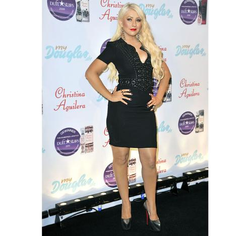 Christine Aguilera - She looks like she ready to bust out her dress! Yikes!