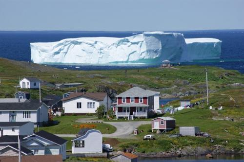 Wow! - This the Island of New Foundland. That is an iceberg just off shore! It is melting but can you imagine what people thought when they saw this? Crazy!