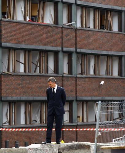 Tragedy - The Prime Minister of Norway at the site where that crazy man shot all those people in the past week,in that shooting rampage.