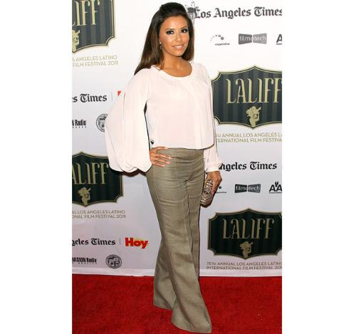Eva Longoria - A different look for Eva. I don't care for it! I would rather see her in a sexy dress!