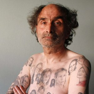 Tattoos - This man have over 80 tattoo's of Julia Roberts on his body! It is didturbing!