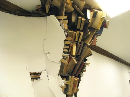 Art? - Seriously? It looks like books are going to crashing through the wall at any moment!They say it is art not what I said it looked like!