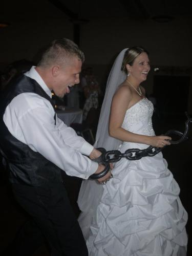 John and sarah - A month ago my friends John and Sarah got married. During the wedding someone put huge hand cuffs on John and Sarah was leading him around! Usually someone puts a ball and chain around the guys leg! I will tell you nthis,Sarah does wear the pants in the marriage! Big time!