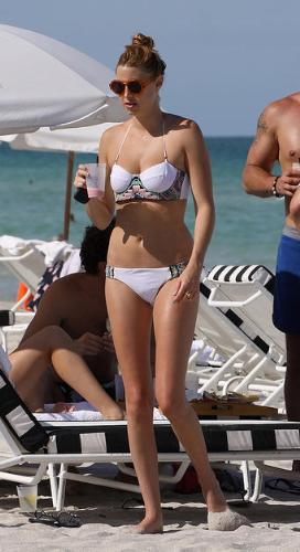Swimsuit - I do not like this style of bikini. It makes the woman look like she has really small breasts!