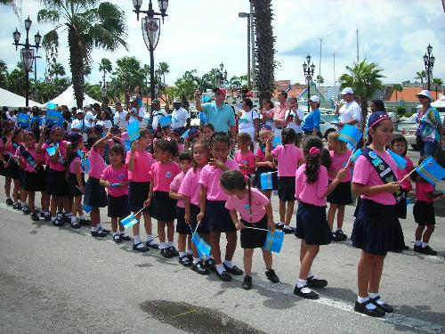 Flag parade in Aruba - All schools parade, even the tiny children. They look cute with their national flag.