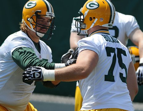 right tackles - Number 65 is no longer with the Pack and I am not happy,still! I miss Mark Tauscher! Bryan Bulaga is now the right tackle and so far he has done good.