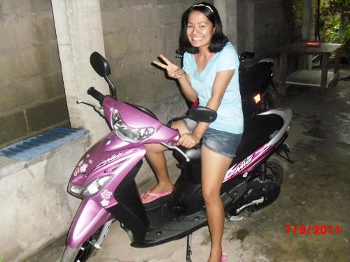 Yamaha scooter - pink during day and violet at night