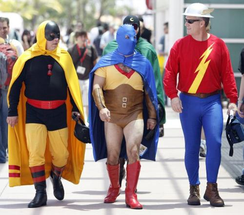 Super Heroes - Three Men dressed as Super Heroes on their way to a Super Hero convention.