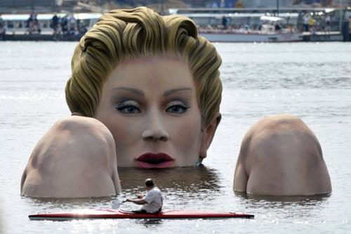 Statue in lake - It is a lake by Hamburg Germany until the 12 of August. People call it the 'Mermaid'.