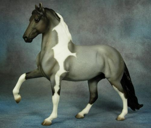 Pinto Paso Fino - This is a Breyer Horse model. They can be played with but there are a lot of adults who collect them! I did once!