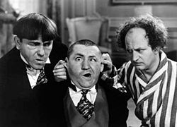 The Three Stooges - I remember growing up the Three Stooges were on tv on the weekends! Here Curly is getting his ears twisted by Moe and Larry!