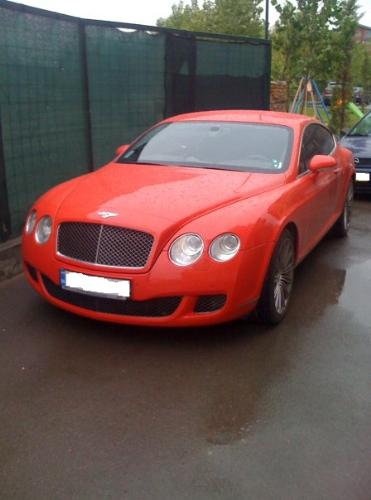 Bentley - This red beast i captured in my hood, is owned by a very clever person.