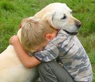 Death & grief - A boy holding tightly onto his dog, a sense that the dog won't live any longer and that this young boy has to confront of one the major events of his life.