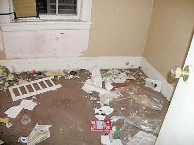 The damage that the tenants did. - This is just one of the rooms the tenants trashed.