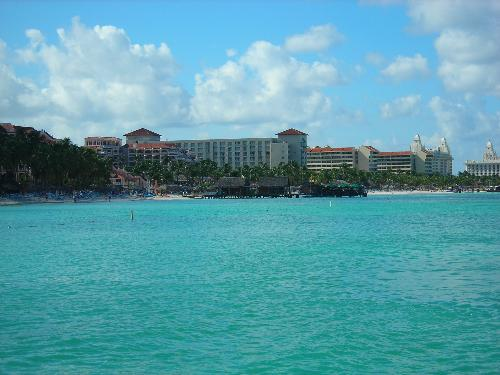 Aruba fom a boat - This is part of the island. It has many resorts and Hotels, but you can also get cheaper places to go.