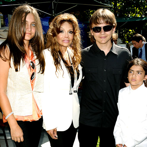 The Jacksons - Paris Jackson,Latoya Jackson,Prince Jackson and Blanket Jackson. Micheal's kids are doing great!